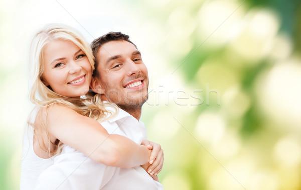 happy couple having fun over poppy flowers field Stock photo © dolgachov