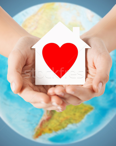 human hands holding paper house with red heart Stock photo © dolgachov