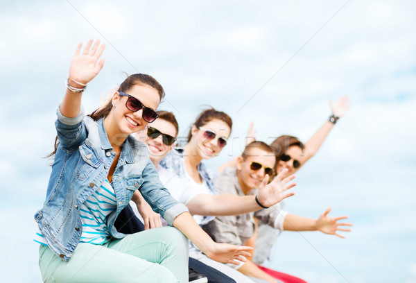 group of teenagers waving hands Stock photo © dolgachov