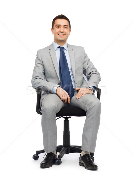 happy businessman  sitting in office chair Stock photo © dolgachov