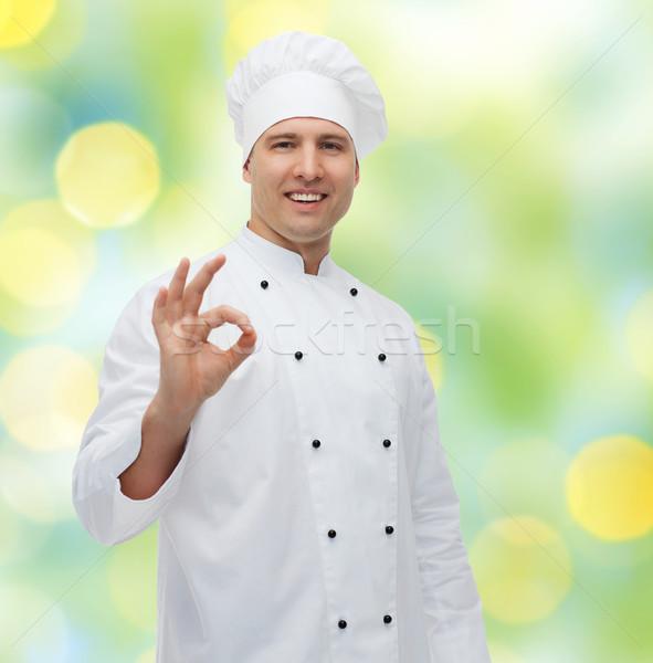Mutlu erkek şef pişirmek neden Stok fotoğraf © dolgachov