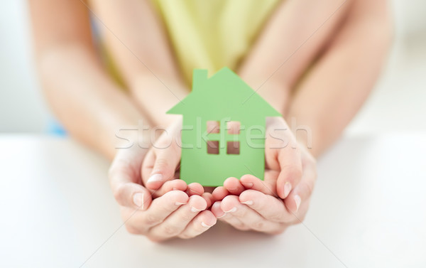 close up of woman and girl hands with paper house Stock photo © dolgachov