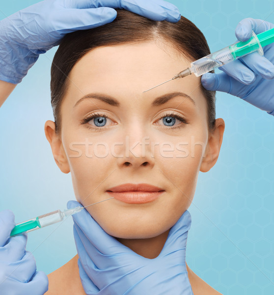 Stock photo: woman face and surgeon hands with syringes