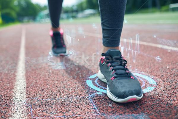 close up of woman feet running on track Stock photo © dolgachov