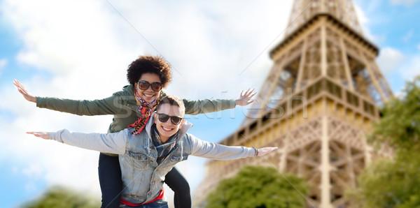 happy teenage couple over paris eiffel tower Stock photo © dolgachov