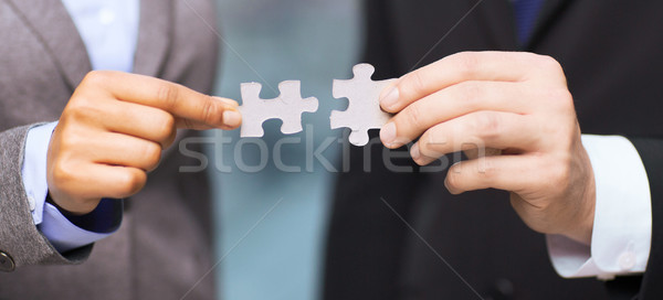 businessman and businesswoman with puzzle pieces Stock photo © dolgachov