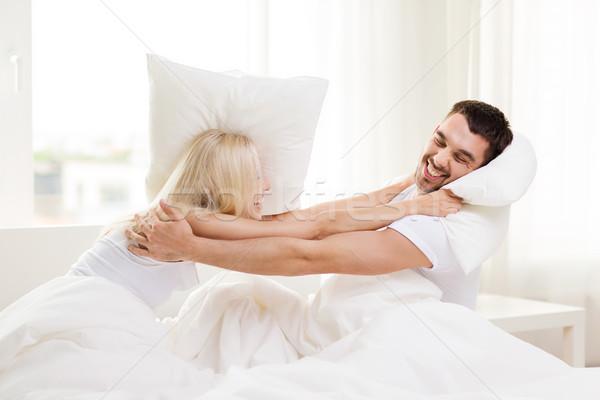Mutlu çift yastık kavgası yatak ev insanlar Stok fotoğraf © dolgachov