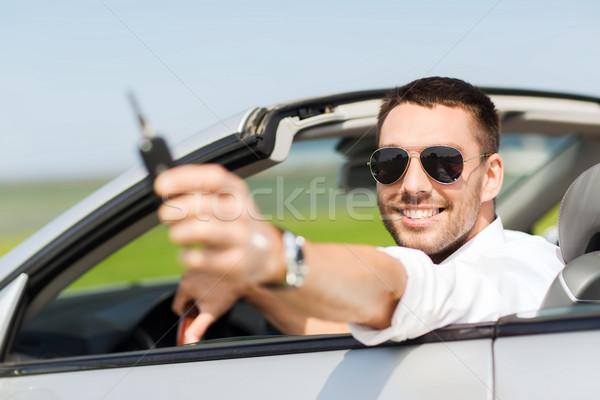Feliz homem cabriolé automático Foto stock © dolgachov