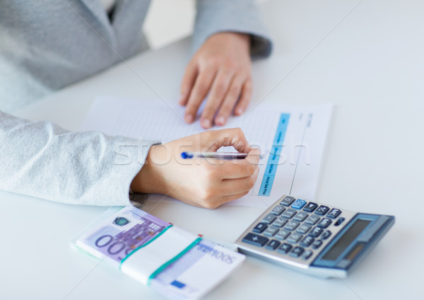 close up of hands counting money with calculator Stock photo © dolgachov