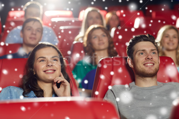 happy friends watching movie in theater Stock photo © dolgachov