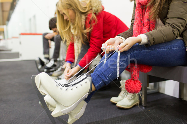 close up of woman wearing skates on skating rink Stock photo © dolgachov