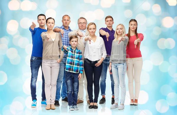 Pessoas do grupo para baixo gesto família sexo Foto stock © dolgachov