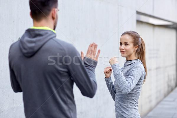 Feliz mulher treinador greve ao ar livre Foto stock © dolgachov