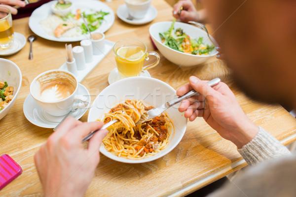 close up man eating pasta for dinner at restaurant Stock photo © dolgachov