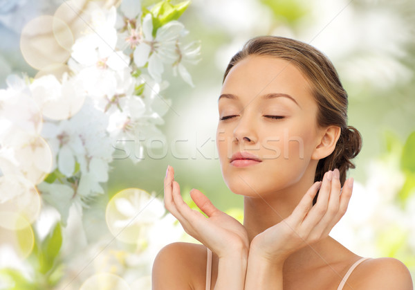 young woman face and hands Stock photo © dolgachov
