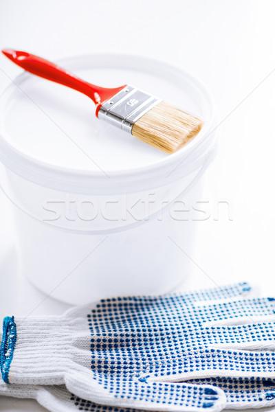 paintbrush, paint pot and gloves Stock photo © dolgachov