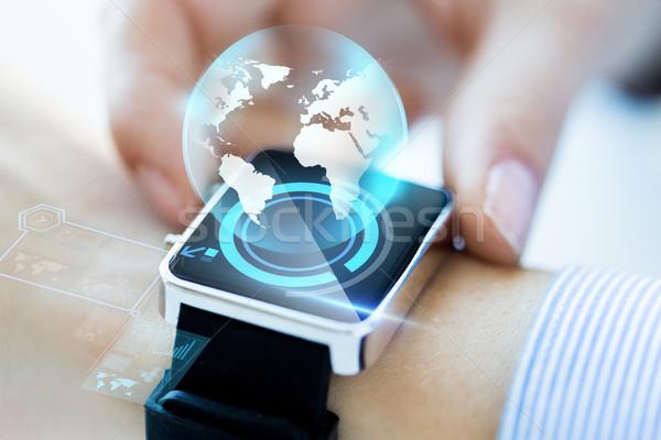 Közelkép kéz földgömb hologram üzlet technológia Stock fotó © dolgachov