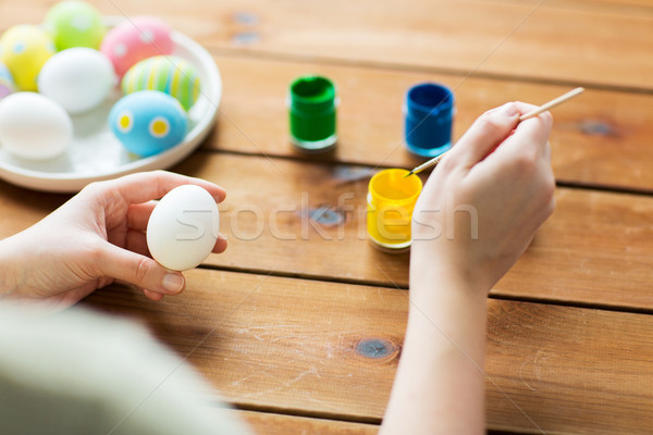 close up of woman coloring easter eggs Stock photo © dolgachov