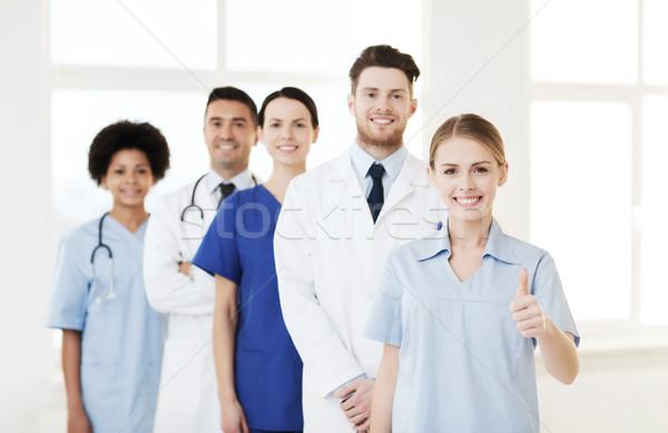 group of doctors and nurses at hospital Stock photo © dolgachov