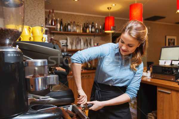 barista woman making coffee by machine at cafe Stock photo © dolgachov