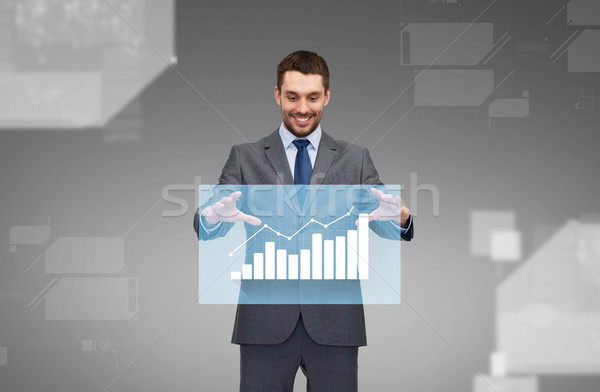 businessman working with virtual chart projection Stock photo © dolgachov