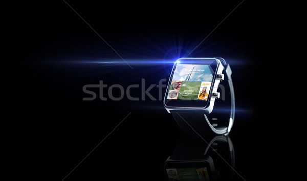 Stock photo: close up of smart watch with media application