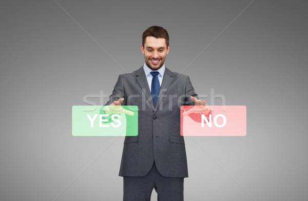 Glimlachend zakenman ja geen knoppen business Stockfoto © dolgachov