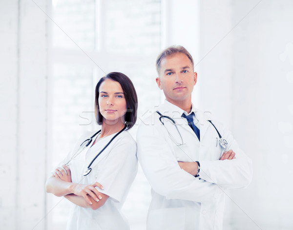 two doctors with stethoscopes Stock photo © dolgachov