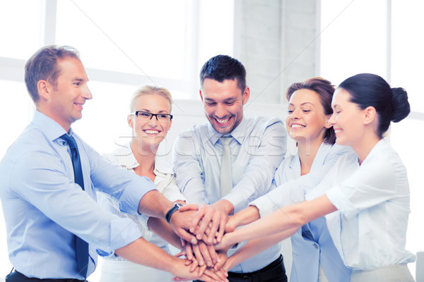 business team celebrating victory in office Stock photo © dolgachov