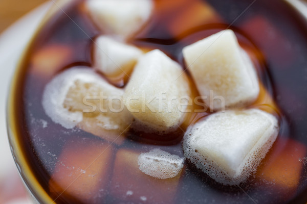 close up of lump sugar in coffee cup or tea Stock photo © dolgachov