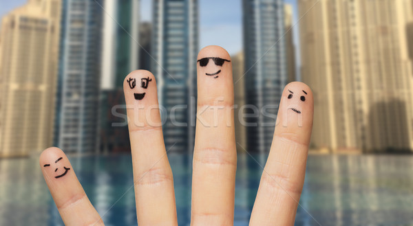 close up of fingers with smiley faces Stock photo © dolgachov