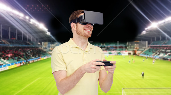 man in virtual reality headset over football field Stock photo © dolgachov