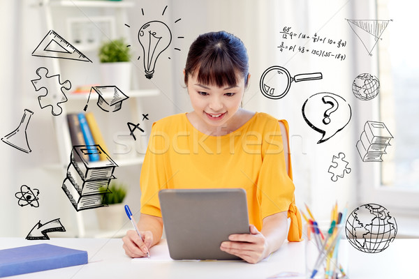 Stock photo: asian woman student with tablet pc at home