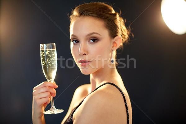 молодые азиатских женщину питьевой шампанского вечеринка Сток-фото © dolgachov