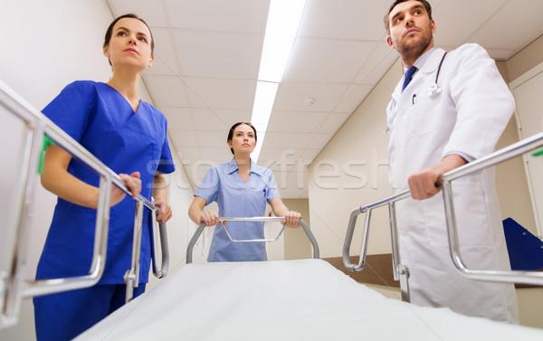 medics carrying hospital gurney at emergency Stock photo © dolgachov