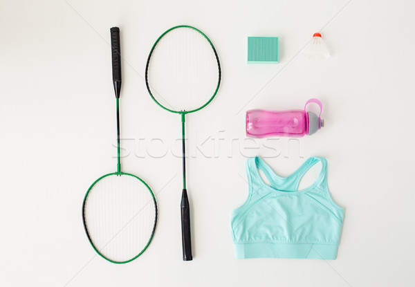 close up of badminton rackets with sports stuff Stock photo © dolgachov