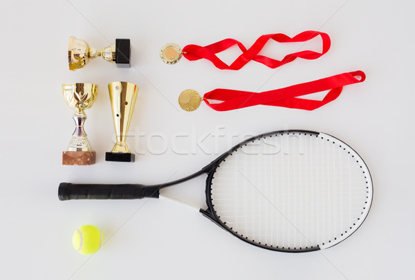 close up of tennis racket, ball, cups and medals Stock photo © dolgachov