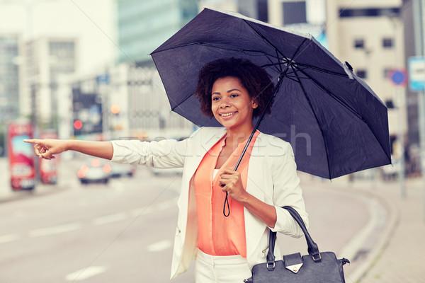 счастливым африканских женщину зонтик такси командировка Сток-фото © dolgachov