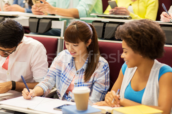 group of international students talking on lecture Stock photo © dolgachov