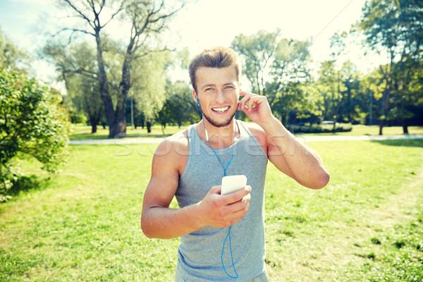 Feliz homem parque fitness Foto stock © dolgachov