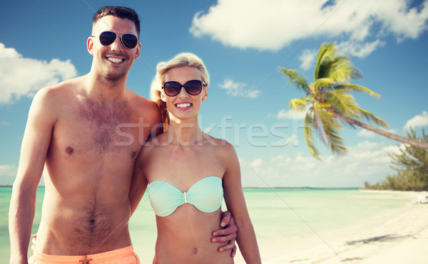 happy couple in swimwear hugging over summer beach Stock photo © dolgachov