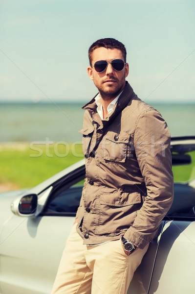 man near cabriolet car outdoors Stock photo © dolgachov