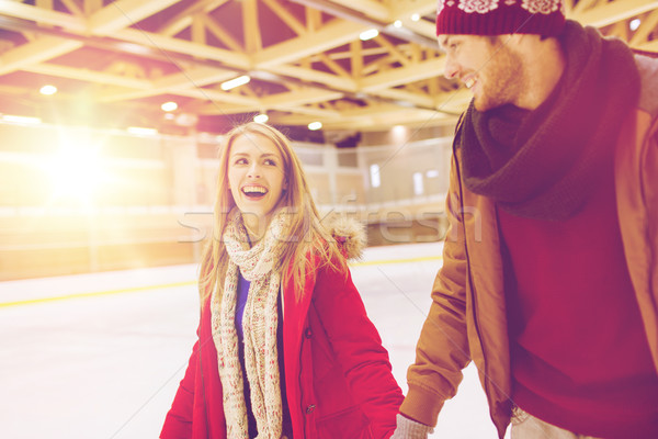 happy couple holding hands on skating rink Stock photo © dolgachov