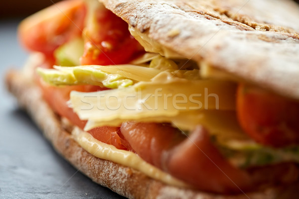 close up of panini sandwich with salmon and cheese Stock photo © dolgachov