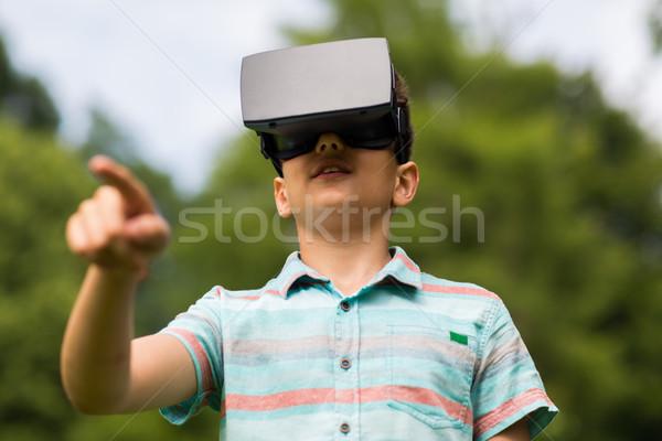 boy with virtual reality headset outdoors Stock photo © dolgachov