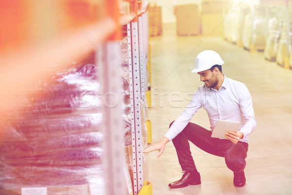 happy businessman with tablet pc at warehouse Stock photo © dolgachov