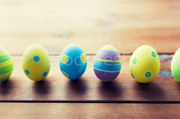 close up of colored easter eggs on wooden surface Stock photo © dolgachov