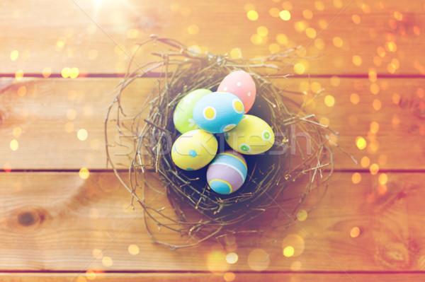 œufs de Pâques nid bois Pâques Photo stock © dolgachov
