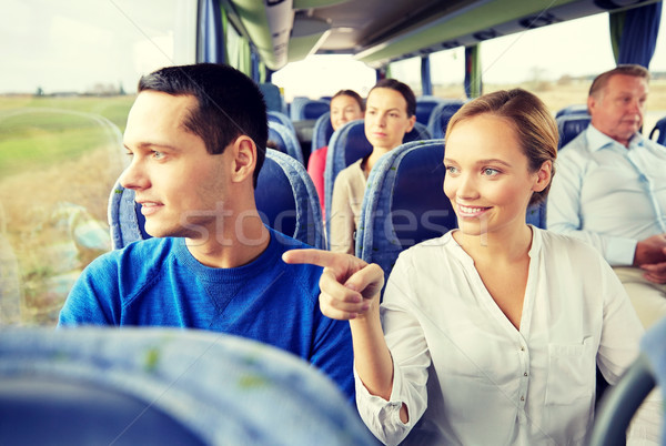 happy couple or passengers in travel bus Stock photo © dolgachov