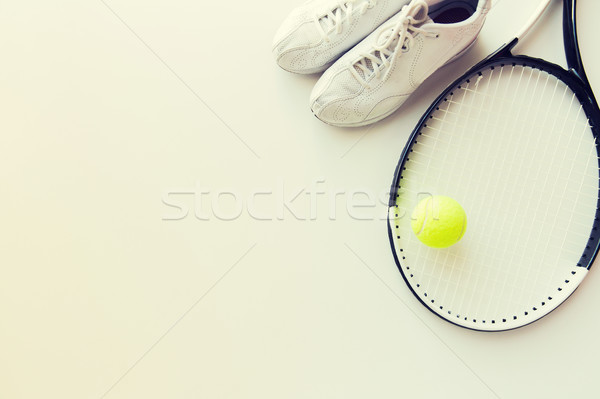 close up of tennis racket with ball and sneakers Stock photo © dolgachov